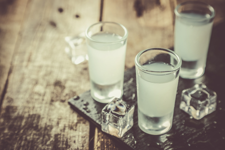 Traditional greek vodka - ouzo in shot glasses Stock Photo - 113299437