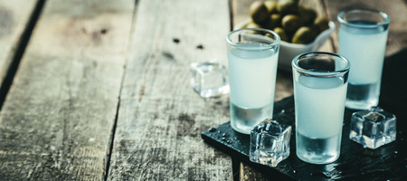 Traditional greek vodka - ouzo in shot glasses Stock Photo