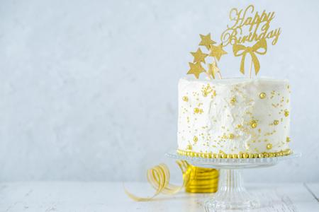 Golden birthday concept - cake, presents, decorations Stock Photo
