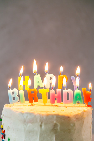 Colorful birthday concept - cake, candles, presents, decorations Stock Photo