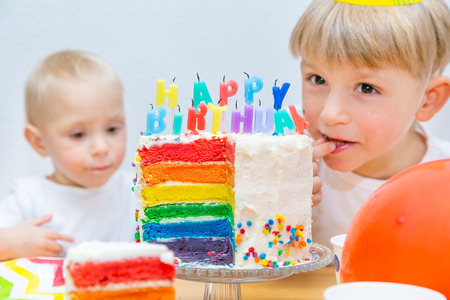 Birthday party concept - colourful cake with candles and kids Reklamní fotografie