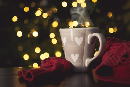 Hot chocolate with marshmallow in front of christmas tree