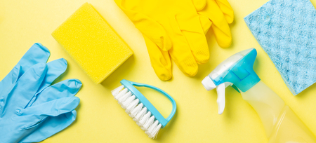 Cleaning concept - blue and yellow cleaning supplies