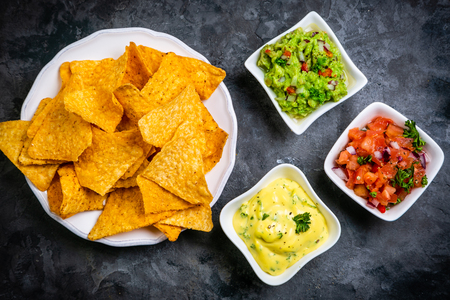 Selection of mexican sauces - salsa, guacamole, cheese sauce