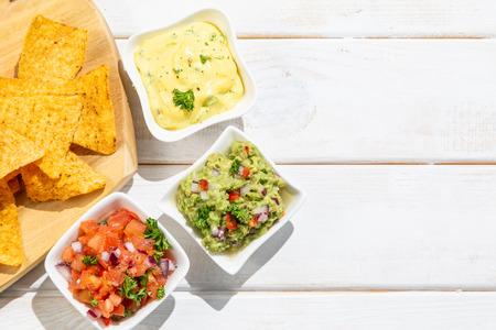 Selection of mexican sauces - salsa, guacamole, cheese sauce