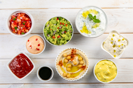 Selection of sauces in white bowls on white bowls 스톡 콘텐츠 - 116033398