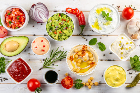 Selection of sauces in white bowls on white bowls Banque d'images - 116033399