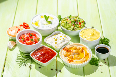 Selection of sauces in white bowls on white bowls