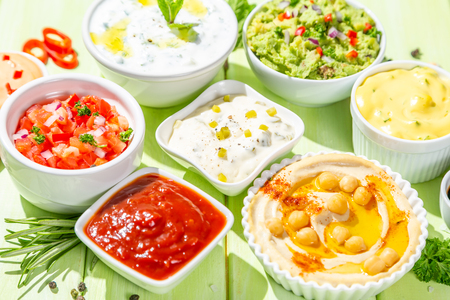 Selection of sauces in white bowls on white bowls Foto de archivo