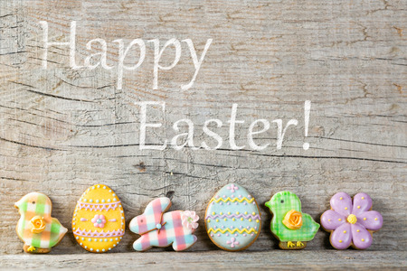 Easter concept - cookies on wood background