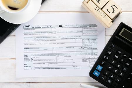 Tax day concept - calculator, calendar, tax form