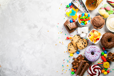 Selection of colorful sweets - chocolate, donuts, cookies, lollipops, ice cream