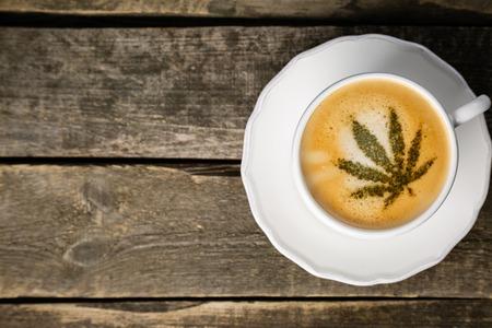 Cannabis coffee - marijuana leaf on coffee foam 写真素材