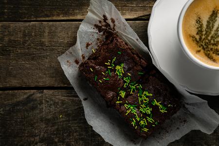 Cannabis coffee - marijuana leaf on coffee foam 스톡 콘텐츠