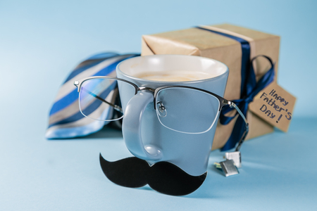 Fathers day concept - present, coffee, tie, mustache
