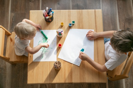 Kids painting with different materials