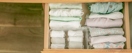 Marie Kondo tyding up method concept - folded clothes