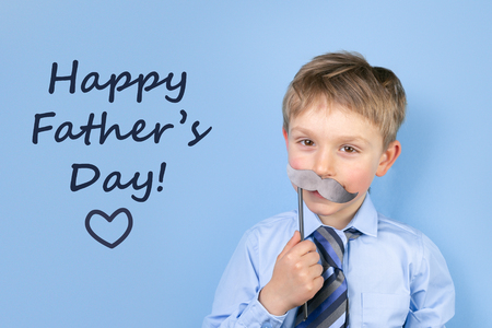 Fathers day concept - boy wears formal shirt and tie just blue background Stok Fotoğraf - 121323760