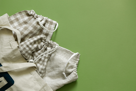 Zero waste concept - reusable cotton bags and glass jars on green Stok Fotoğraf
