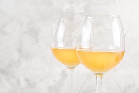 Orange wine in glasses.