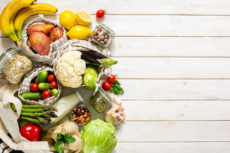 Zero waste shopping concept - groceries in textile bags and glass jars, top view Stock Photo