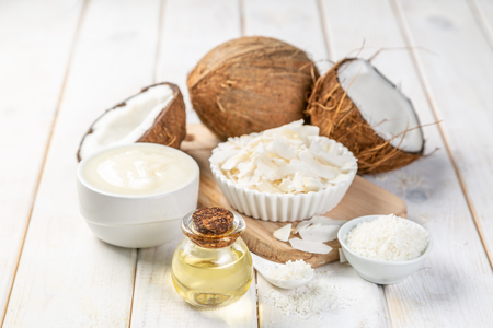 MCT coconut oil concept - coconuts, butter and oil on wood 写真素材