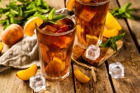 Lemon and peach iced tea on wooden background 스톡 콘텐츠 - 125133068