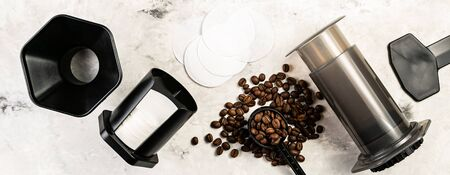 Coffee concept - beans, ground, instant, capsules, aeropress marble background top view Stock Photo
