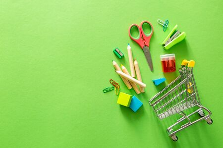 BAck to school concept - supplies on green background