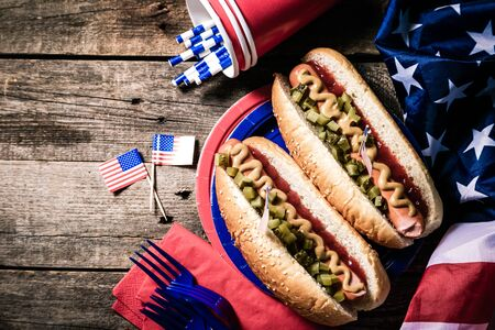 USA national holiday Labor Day, Memorial Day, Flag Day, 4th of July - hot dogs with ketchup and mustard on wood background Banco de Imagens - 128326942