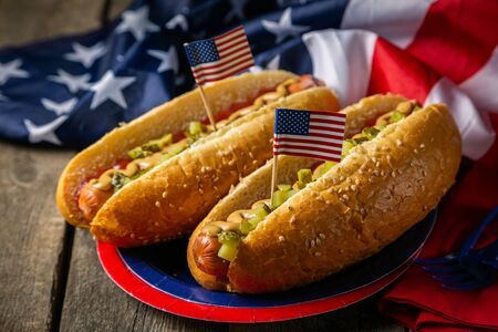 USA national holiday Labor Day, Memorial Day, Flag Day, 4th of July - hot dogs with ketchup and mustard on wood background Banco de Imagens - 128340944