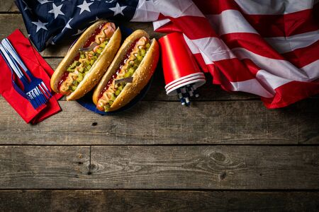 USA national holiday Labor Day, Memorial Day, Flag Day, 4th of July - hot dogs with ketchup and mustard on wood background Banco de Imagens - 128340946