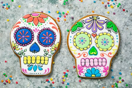 Dia de los muertos concept - skull shaped cookies with colorful decorations