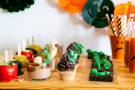 Halloween style party candy bar and decorations