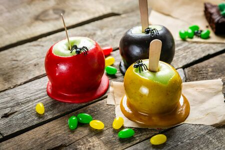 Halloween style sweets - black poisoned, red and orange caramel apples