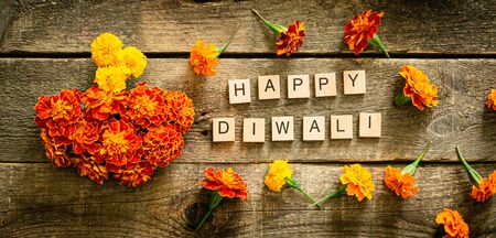 Diwali holiday concept - marigold flowers on wood background 스톡 콘텐츠