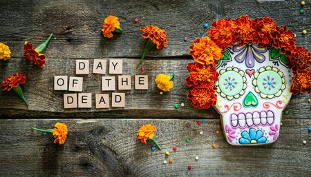 Day of the dead concept dia de los muertos - skull shapes cookie with marigold flowers