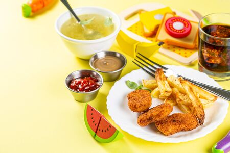 Kids menu concept - pasta, nuggets, french fries, soups, cola Standard-Bild - 131017275