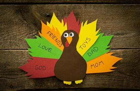 Thanksgiving paper craft - thanksful turkey on wood background