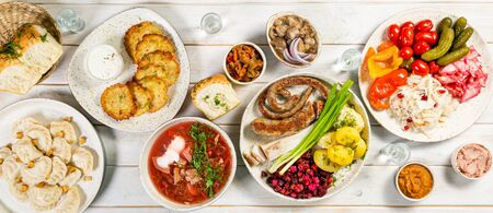 Selection of traditional ukrainian food - borsch, perogies, potato cakes, pickled vegetables 写真素材
