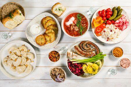 Selection of traditional ukrainian food - borsch, perogies, potato cakes, pickled vegetables