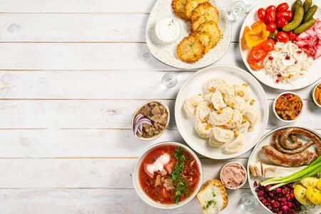 Selection of traditional ukrainian food - borsch, perogies, potato cakes, pickled vegetables Stock fotó