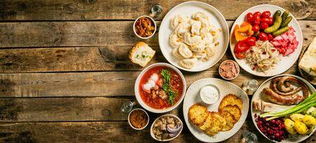 Selection of traditional ukrainian food - borsch, perogies, potato cakes, pickled vegetables Banco de Imagens
