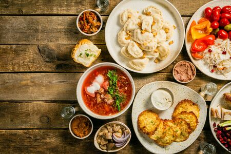 Selection of traditional ukrainian food - borsch, perogies, potato cakes, pickled vegetables Stock fotó