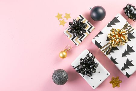 Selection of white, gold and black coloured christmas gift boxes Stock Photo - 134401728