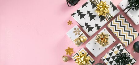 Selection of white, gold and black coloured christmas gift boxes Stock Photo - 134401781