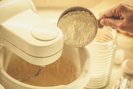 Baking concept - batter in mixer and ingredients
