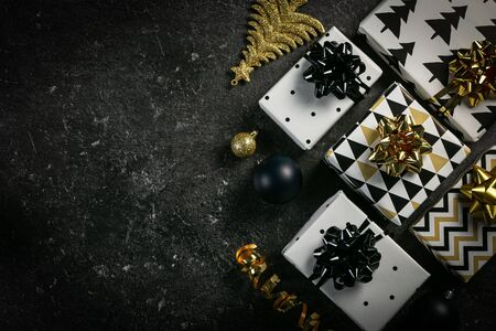 Christmas concept - black and golden presents and decorations