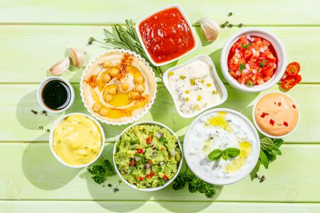 Selection of sauces in white bowls on white bowls Reklamní fotografie