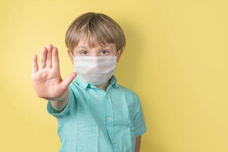 Coronavirus cocept - boy wearing face mask